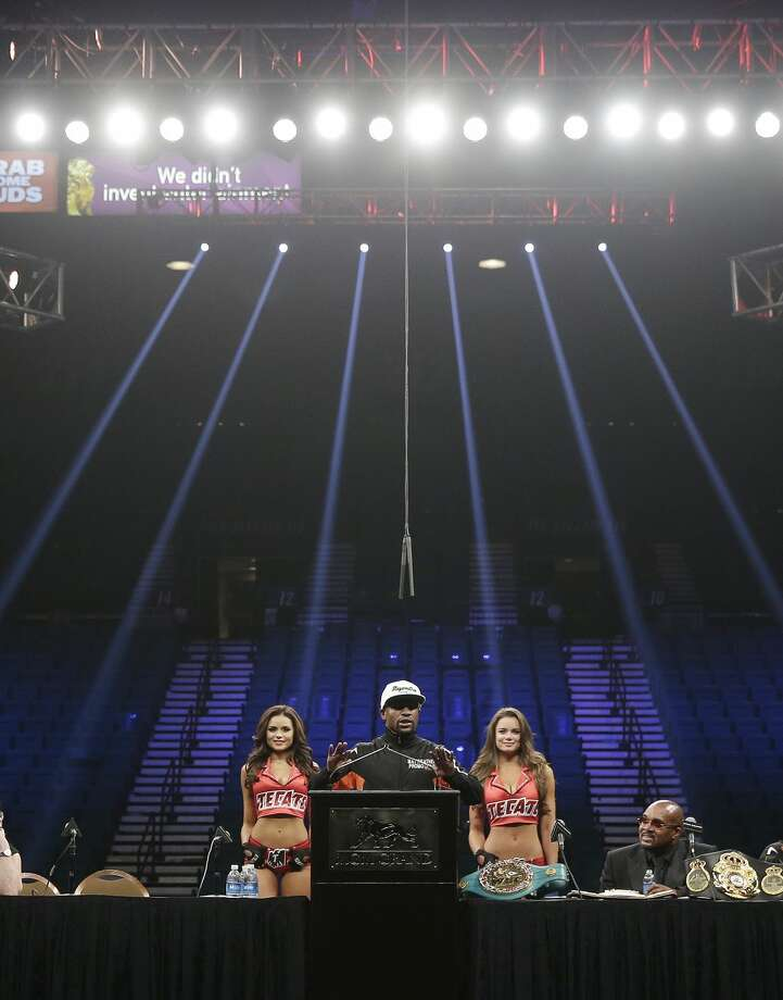 Floyd Mayweather Jr. answers reporter questions during a press conference following his welterweight title fight against Manny Pacquiao on Saturday, May 2, 2015 in Las Vegas. Mayweather defeated Manny Pacquiao in a unanimous decision. (AP Photo/John Locher)