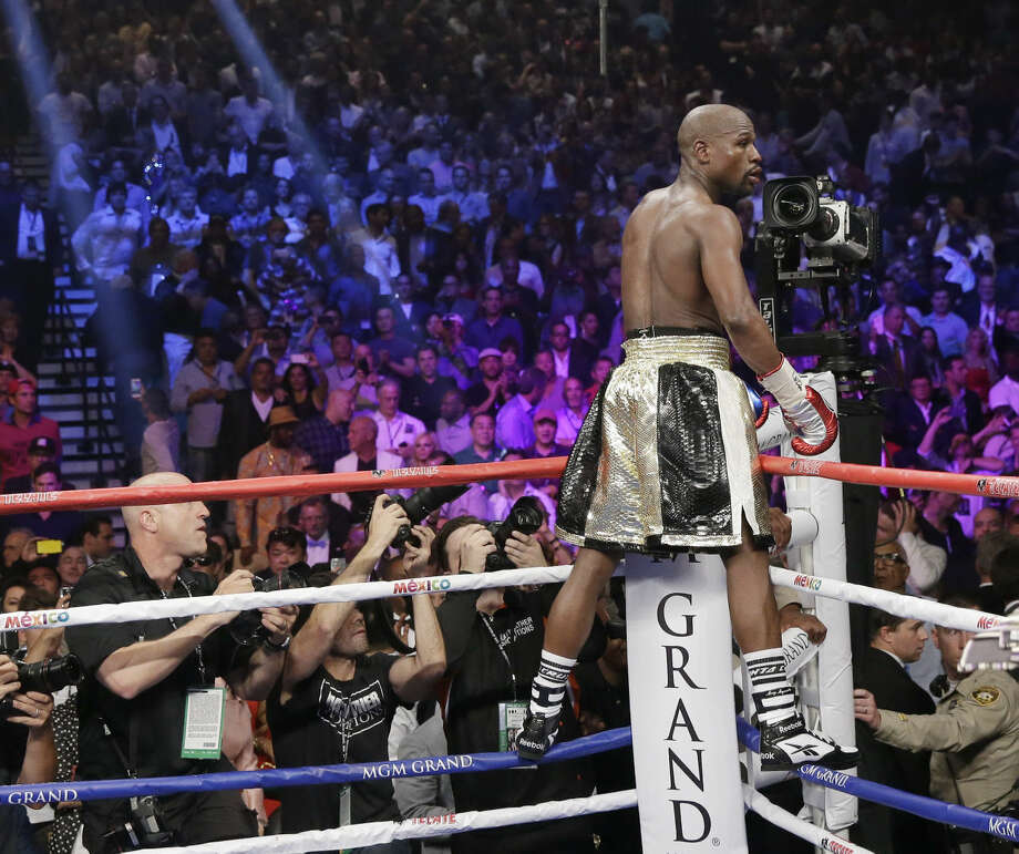 Floyd Mayweather Jr., reacts on his corner after the welterweight title fight against Manny Pacquiao, from the Philippines, on Saturday, May 2, 2015 in Las Vegas. (AP Photo/Isaac Brekken)