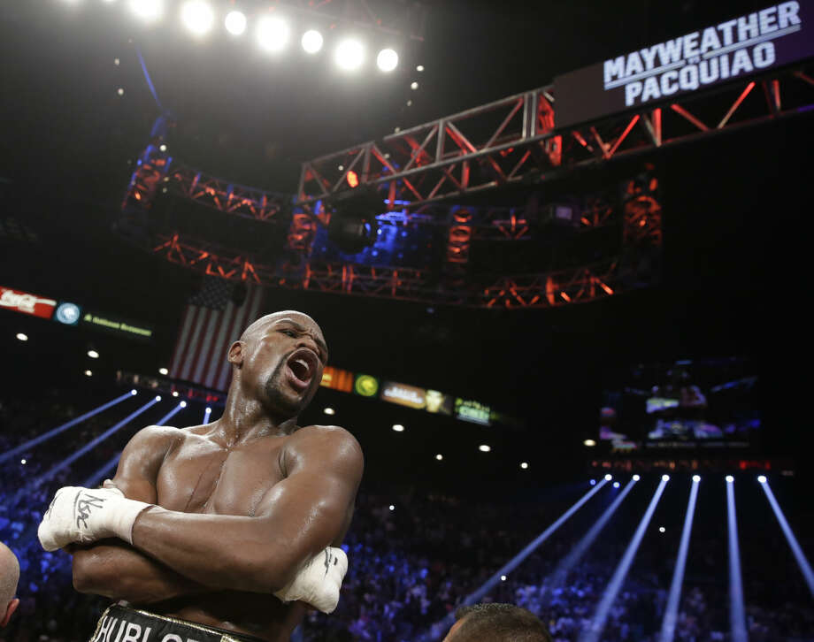 Floyd Mayweather Jr., reacts after the welterweight title fight against Manny Pacquiao, from the Philippines, on Saturday, May 2, 2015 in Las Vegas. (AP Photo/Isaac Brekken)