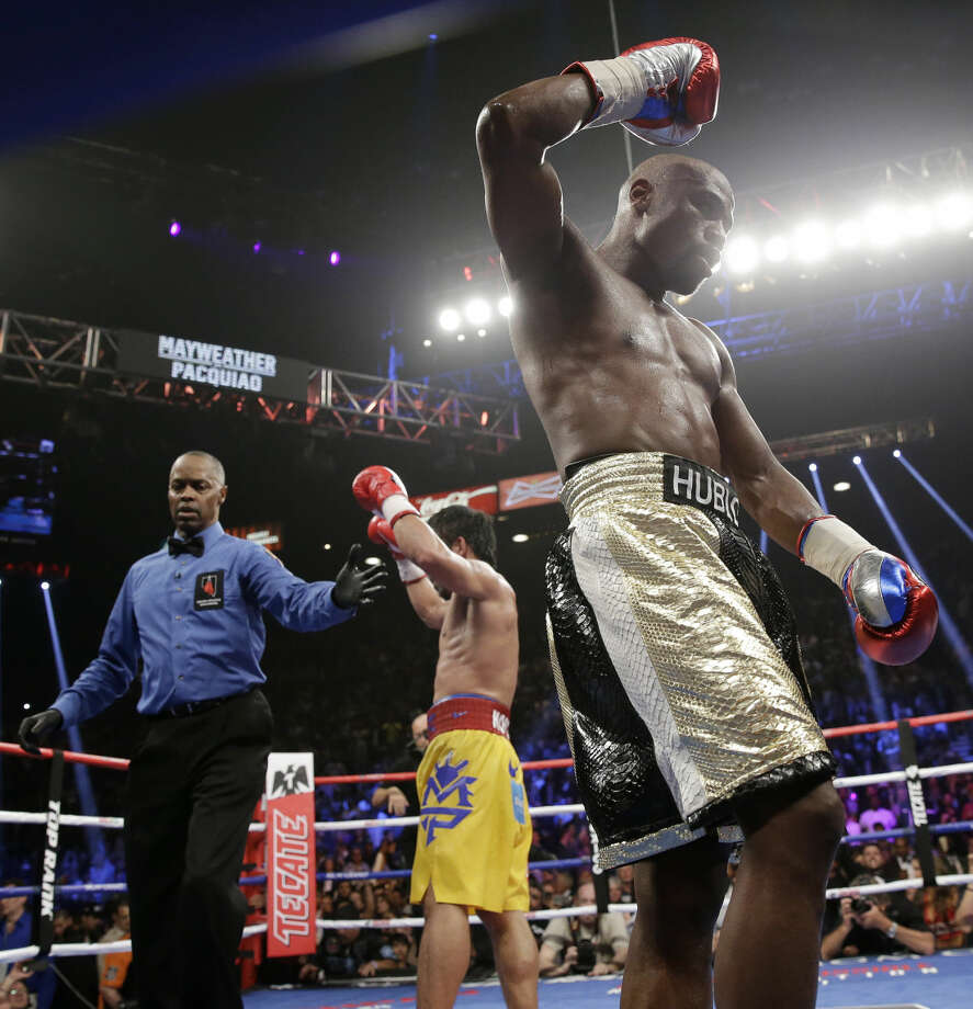 Floyd Mayweather Jr., right, reacts after the welterweight title fight against Manny Pacquiao, from the Philippines, on Saturday, May 2, 2015 in Las Vegas. (AP Photo/Isaac Brekken)