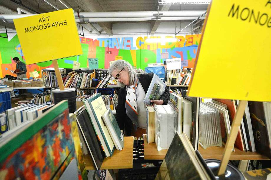 Diane Storch looks over books on gardening during the Wilton Library Annual Gigantic Book Sale on Sunday in Wilton.