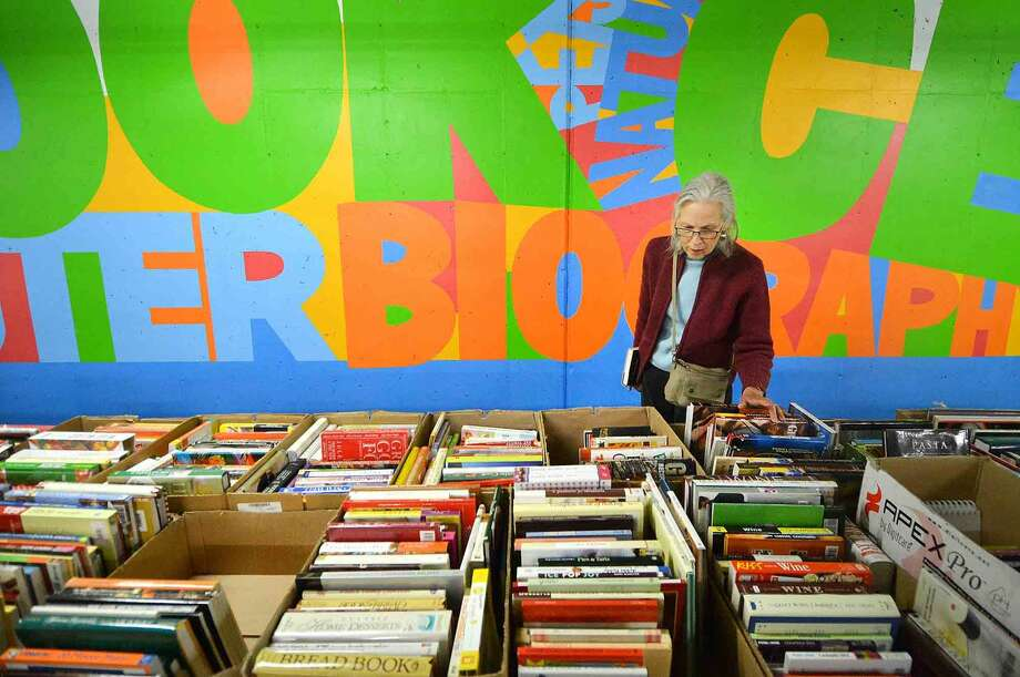 Carole Segal looks through some of the thousands of books for sale during the Wilton Library Annual Gigantic Book Sale on Sunday in Wilton.