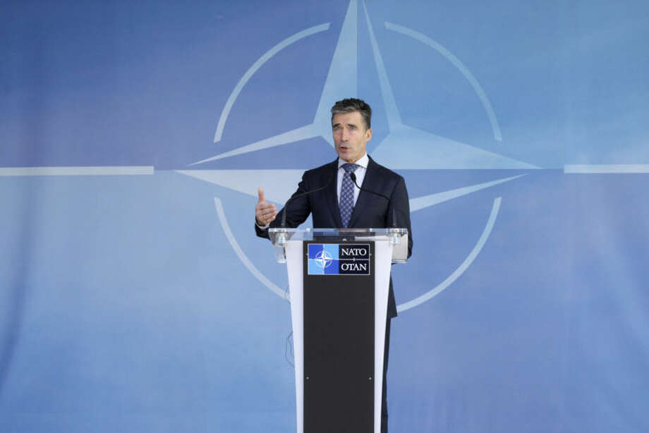 NATO Secretary General Anders Fogh Rasmussen addresses the media after an NATO Ambassadors Council at NATO headquarters in Brussels, Wednesday, April 16, 2014. NATO says it's reinforcing its military presence on eastern border on sea, land and in the air. (AP Photo/Yves Logghe)