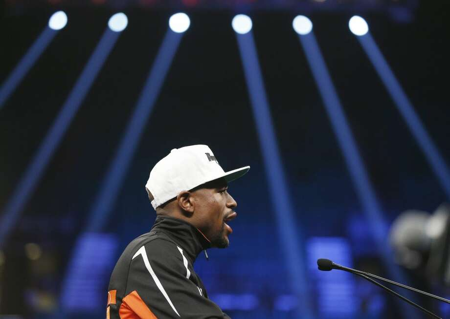 Floyd Mayweather Jr. speaks during a press conference following his welterweight title fight on Saturday, May 2, 2015 in Las Vegas. Mayweather defeated Manny Pacquiao by unanimous decision. (AP Photo/John Locher)