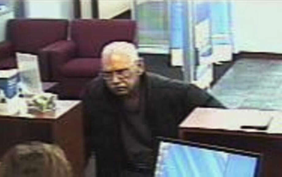 FILE - This Feb. 9, 2013 file surveillance photo provided by the FBI shows 73-year-old Walter Unbehaun, an ex-convict from Rock Hill., S.C., during a bank robbery in Niles, Ill. Unbehaun allegedly told investigators he intended to get caught so he could live his final years behind bars. On Thursday, April 17, 2014, Unbehaun is scheduled to be sentenced in Chicago. In 50 years, he has spent just six out from behind bars. His case highlights a wider societal dilemma about what to do with an increasingly elderly ex-cons, many of whom spent so much of their lives inside prison that they, like Unbehaun, can't cope with life on the outside. (AP Photo/FBI, File)