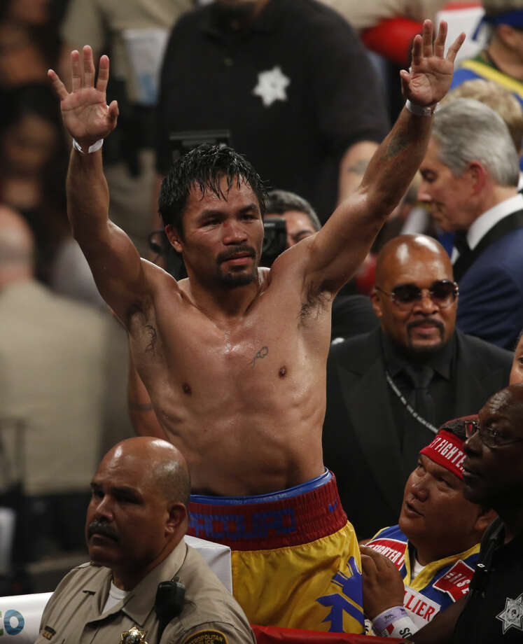 Manny Pacquiao, from the Philippines, greets fans after his welterweight title against Floyd Mayweather Jr., on Saturday, May 2, 2015 in Las Vegas. (AP Photo/Eric Jamison)