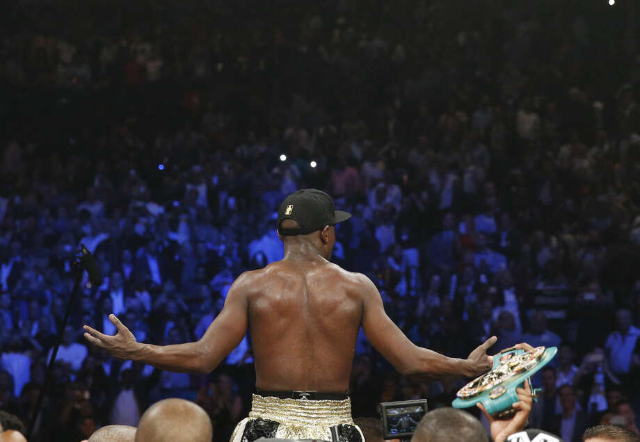 Floyd Mayweather Jr., celebrates his unanimous decision victory over Manny Pacquiao, from the Philippines, at the finish of their welterweight title fight on Saturday, May 2, 2015 in Las Vegas. (AP Photo/John Locher)
