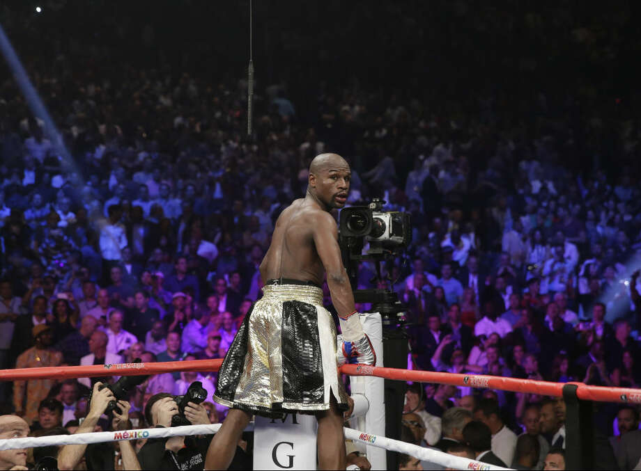 Floyd Mayweather Jr. looks back after greeting the crowd after his win against Manny Pacquiao, from the Philippines, in their welterweight title fight on Saturday, May 2, 2015 in Las Vegas. (AP Photo/Isaac Brekken)