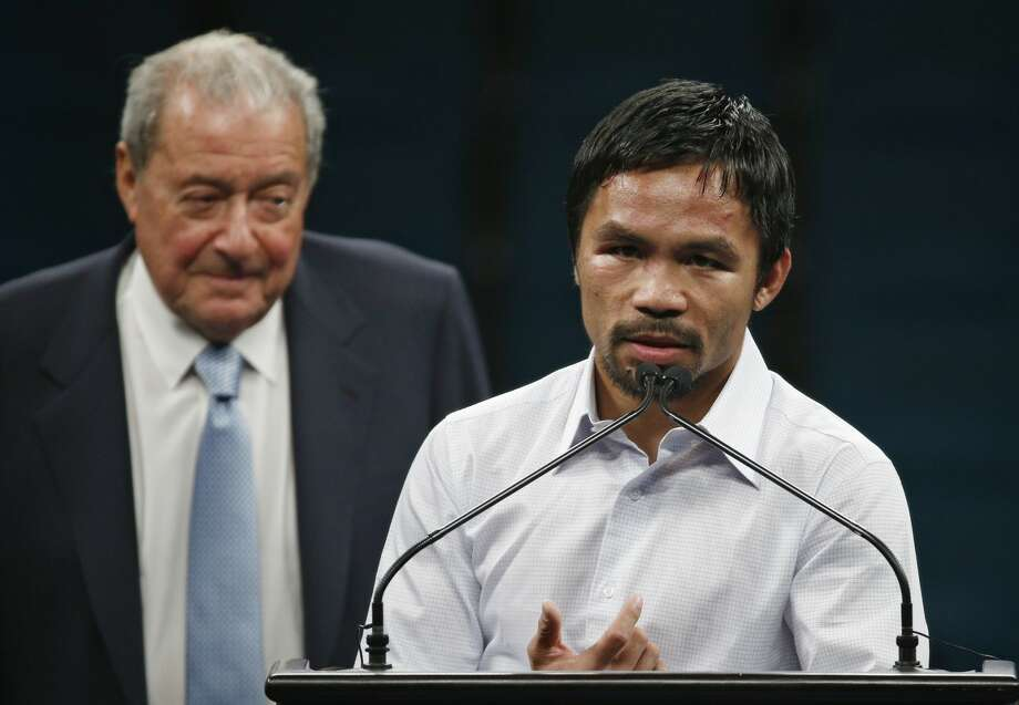 Promoter Bob Arum, left, watches as Manny Pacquiao answers reporter questions during a press conference following his welterweight title fight on Saturday, May 2, 2015 in Las Vegas. Floyd Mayweather defeated Pacquiao in a unanimous decision. (AP Photo/John Locher)