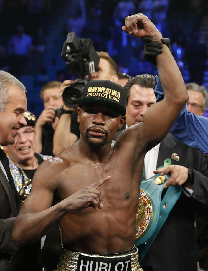 Floyd Mayweather Jr. is named the winner over Manny Pacquiao, from the Philippines, in their welterweight title fight on Saturday, May 2, 2015 in Las Vegas. (AP Photo/John Locher)