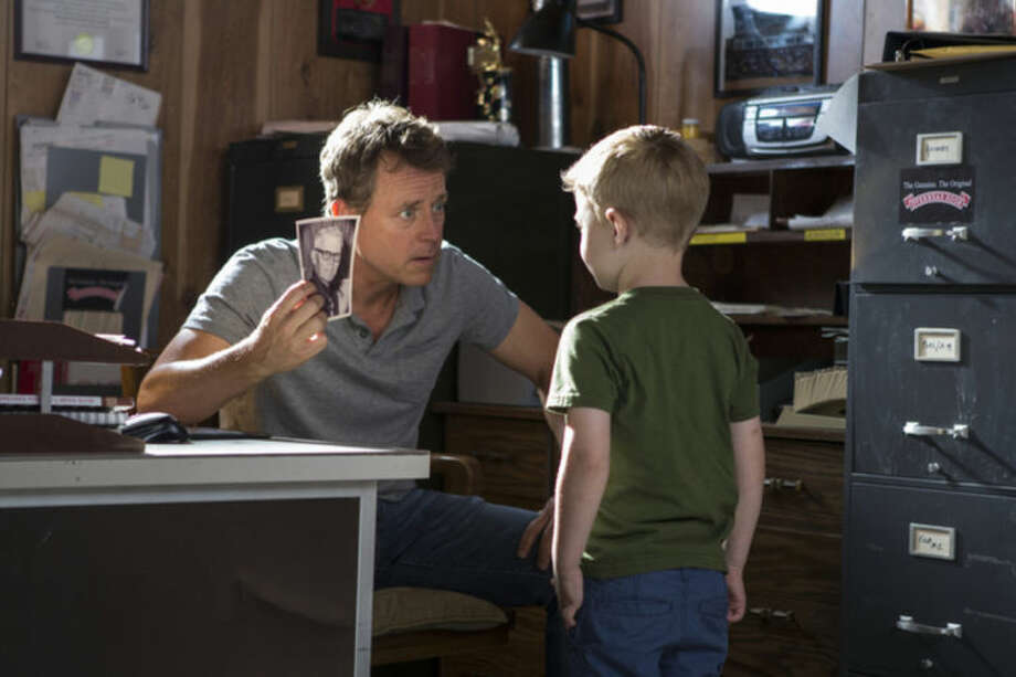 "This image released by Sony Pictures shows Greg Kinnear, left, and Connor Corum in a scene from ""Heaven Is For Real."" (AP Photo/Sony Pictures, Allen Fraser)"