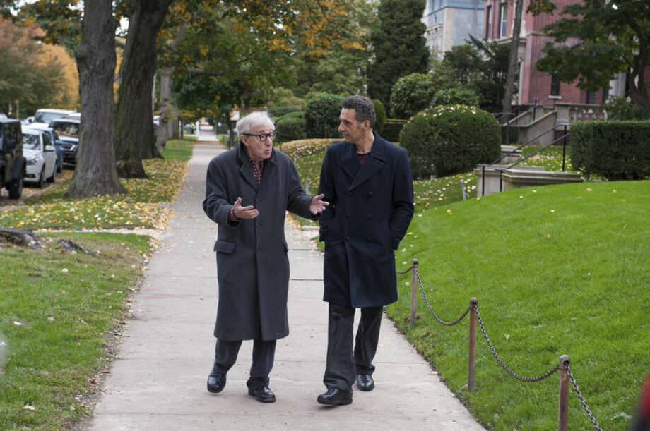 """This image released by Millennium Entertainment shows Woody Allen, left, and John Turturro in a scene from """"Fading Gigolo."""" (AP Photo/Millennium Entertainment, JoJo Whilden)"""