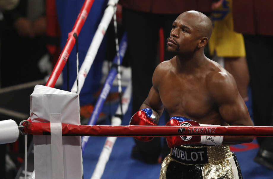 Floyd Mayweather Jr. enters the ring before his welterweight title fight against Manny Pacquiao, from the Philippines, on Saturday, May 2, 2015 in Las Vegas. (AP Photo/Eric Jamison)