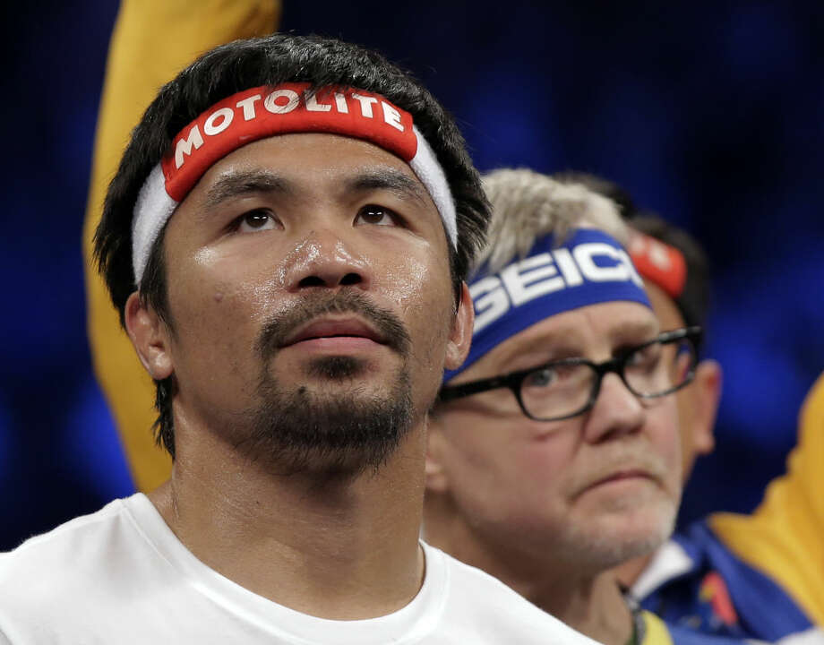 Manny Pacquiao, from the Philippines, gets ready before the welterweight title fight against Floyd Mayweather Jr., on Saturday, May 2, 2015 in Las Vegas. (AP Photo/Isaac Brekken)