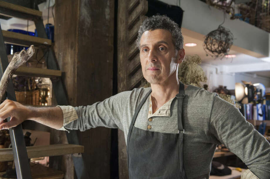"""This image released by Millennium Entertainment shows John Turturro in a scene from """"Fading Gigolo."""" (AP Photo/Millennium Entertainment, JoJo Whilden)"""