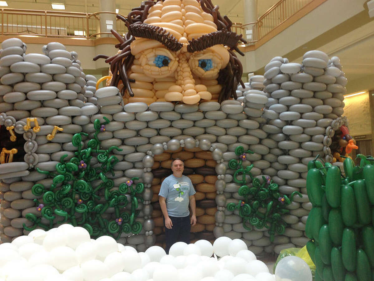 """Contributed photo Norwalk balloon artist Paul Mordoff stands next to the main piece of art of the exhibit """"Balloon Manor 2014: The VERY Tall Tale of Jack and his Beanstalk"""" in Rochester, NY?•s historic, downtown Sibley Building atrium, earlier this year."""