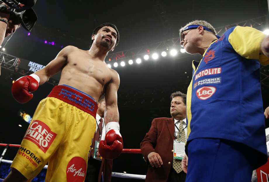 Manny Pacquiao, from the Philippines, gets ready before the welterweight title fight against Floyd Mayweather Jr., on Saturday, May 2, 2015 in Las Vegas. (AP Photo/John Locher)