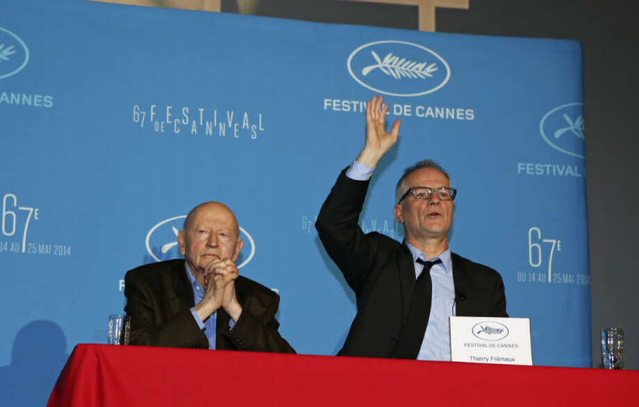 Cannes Film Festival general delegate Thierry Fremaux, right, addresses reporters, as Festival President Gilles Jacob, left, looks on, during a press conference to announce this years line up in Paris, Thursday April 17, 204. A Tommy Lee Jones western and a David Cronenberg exposé on Hollywood are among the 18 films vying for the top prize at the Cannes Film Festival. The festival organizers also said Thursday that two women directors and famed New Wave filmmaker Jean-Luc Godard will be in competition at the festival that runs May 14-25. (AP Photo/Remy de la Mauviniere)