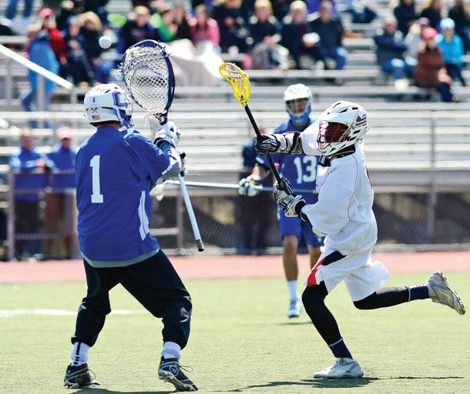 Hour photo / Erik Trautmann Brien McMahon High School Senator, #4, Channing Thomas, shoots over Glastonbury goalie during their CIAC lacrosse game Thursday in Norwalk.