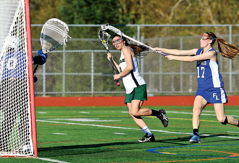 Hour photo / Erik Trautmann The Norwalk High School girls lacrosse team takes on Fairfield Ludlowe during their FCIAC match up Saturday at Testa Field.