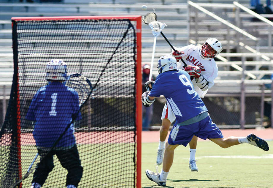 Hour photo / Erik Trautmann The Brien McMahon High School Senators beat Glastonbury in their CIAC lacrosse game Thursday in Norwalk.