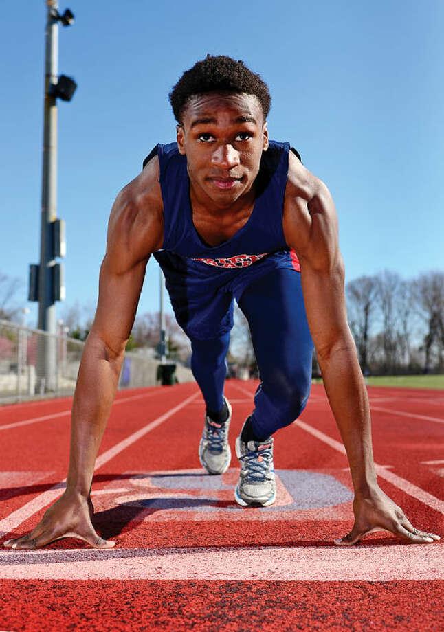 Hour photo / Erik Trautmann Brien McMahon sprinter Shnyden Pierre, Our All-Area MVPfor the indoor track season.