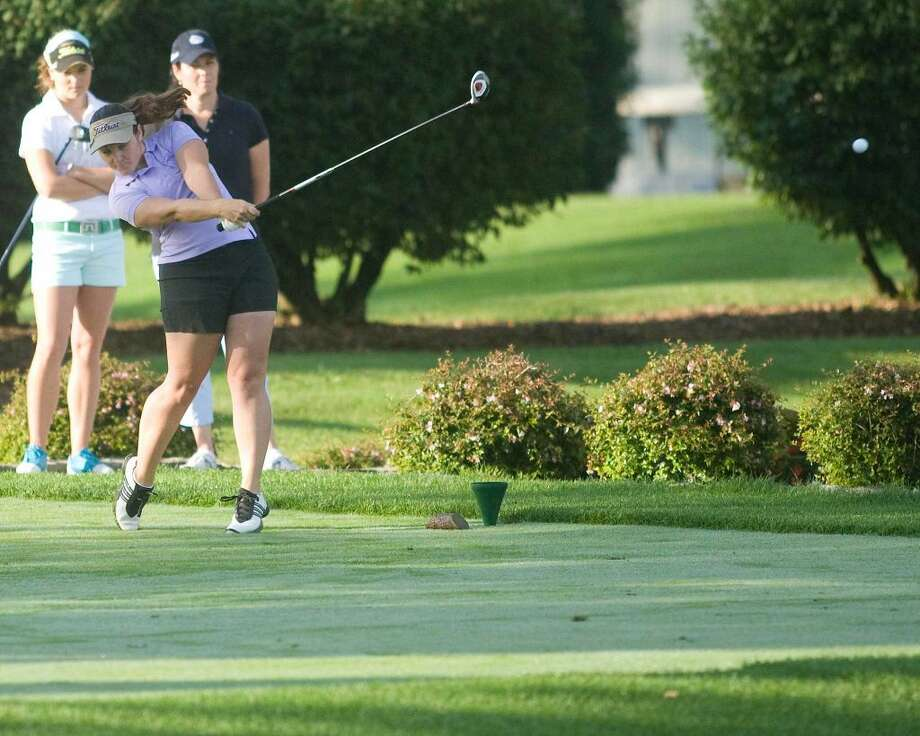 Ellie Dutch hits a tee shot during first round play in the Connecticut State Women's Amateur Golf Championship at Ridgewood Country Club in Danbury.