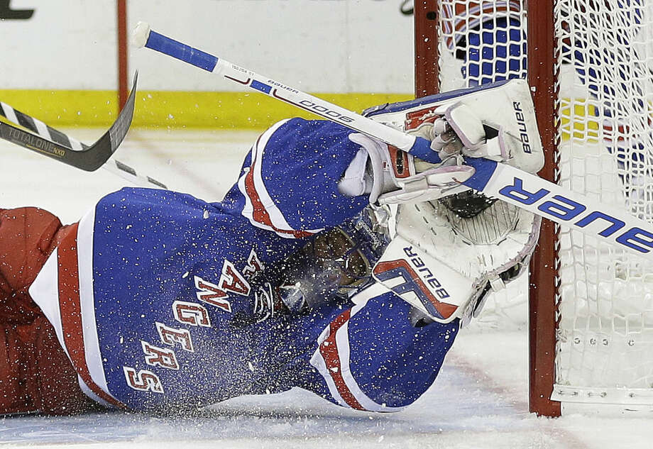 New York Rangers goalie Henrik Lundqvist (30) makes a diving save on a shot by Washington Capitals left wing Alex Ovechkin during the first period of Game 2 in the second round of the NHL Stanley Cup hockey playoffs Saturday, May 2, 2015, in New York. (AP Photo/Frank Franklin II)