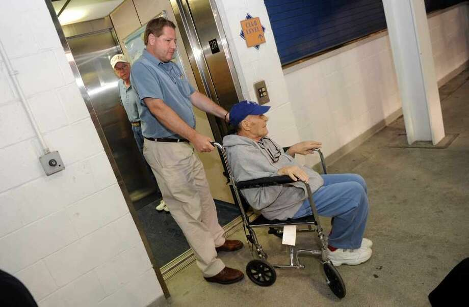 A behind the scenes look at some of the action at a Bluefish ballgame that isn't on the field at the Ballpark at Harbor Yard on Friday August 25, 2011. Alfred Felner, 80, from the Notre Dame Convalescent Home in Norwalk, attends the game. Pushing him in the wheelchair is Dana Paul from the administrative staff at the home.