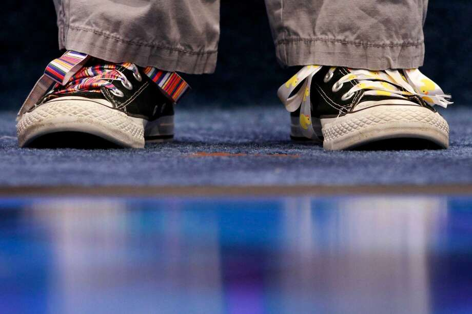 Kayla Sheffield, 13, of Fort Myers, Fla., wears different colored shoe laces as she waits to spell her word during the National Spelling Bee, Wednesday, May 30, 2012, in Oxon Hill, Md. (AP Photo/Jacquelyn Martin)
