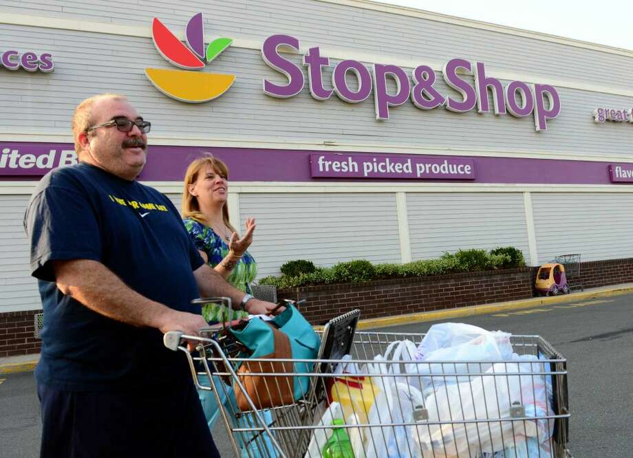 Pete and Mary Vining, of Shelton, walk to their car at the Stop and Shop supermarket off of East main Street in Stratford, Conn. on Tuesday July 22, 2014. Several fruits, like peaches, are being recalled at some chain stores like Stop & Shop, Trader Joe's, and Sam's Club because of listeria.