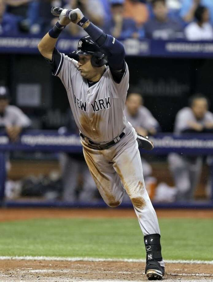 New York Yankees' Derek Jeter ducks away from an inside pitch from Tampa Bay Rays' David Price during fifth inning of a baseball game on Thursday, April 17, 2014, in St. Petersburg, Fla. (AP Photo/Chris O'Meara)