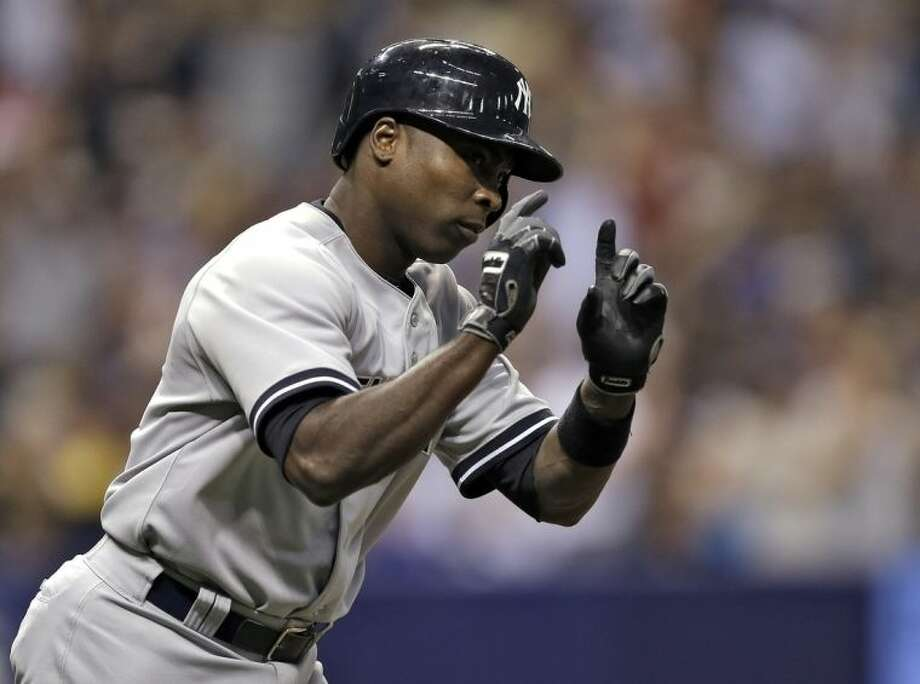 New York Yankees' Alfonso Soriano reacts as he runs around the bases after hitting a home run off Tampa Bay Rays starting pitcher David Price during fifth inning of a baseball game on Thursday, April 17, 2014, in St. Petersburg, Fla. (AP Photo/Chris O'Meara)