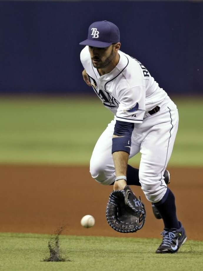 Tampa Bay Rays first baseman Sean Rodriguez cannot field a single hit by New York Yankees' Jacoby Ellsbury off starting pitcher David Price during first inning of a baseball game on Thursday, April 17, 2014, in St. Petersburg, Fla. (AP Photo/Chris O'Meara)