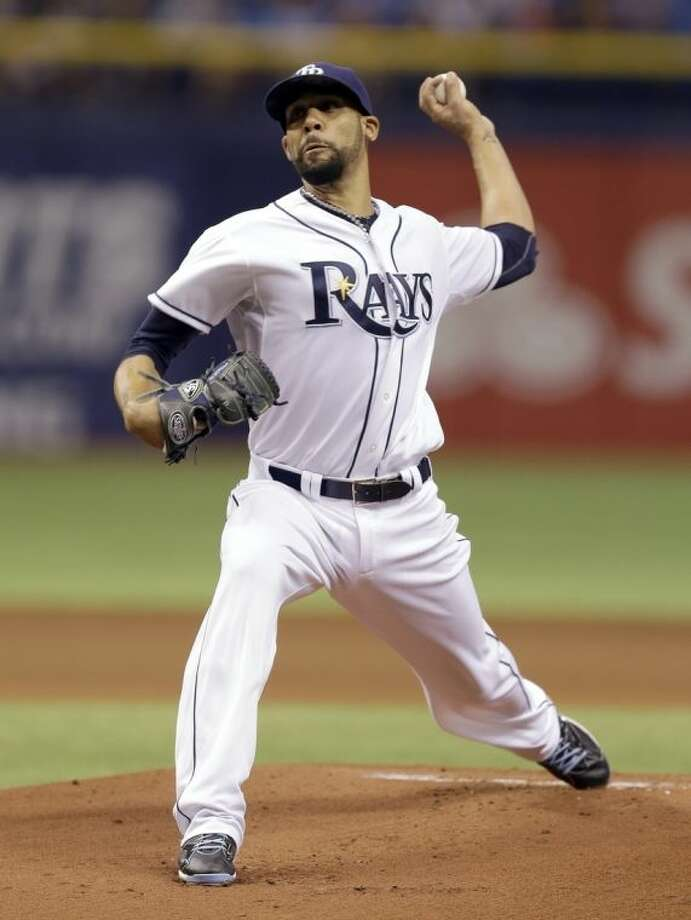 Tampa Bay Rays starting pitcher David Price delivers to New York Yankees' Derek Jeter during first inning of a baseball game on Thursday, April 17, 2014, in St. Petersburg, Fla. (AP Photo/Chris O'Meara)