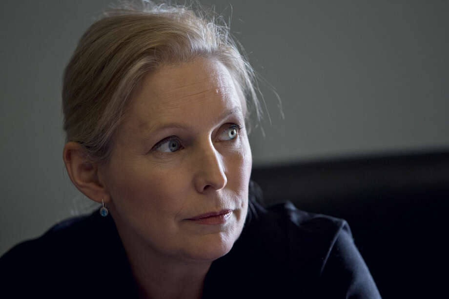Sen. Kirsten Gillibrand, D-N.Y., is interviewed about military sexual assaults, in her Capitol Hill office in Washington, Thursday, April 30, 2015. The spouses of service members and civilian women who live or work near military facilities are especially vulnerable to being sexually assaulted, Sen. Kirsten Gillibrand, D-N.Y. said in a report. (AP Photo/Jacquelyn Martin)