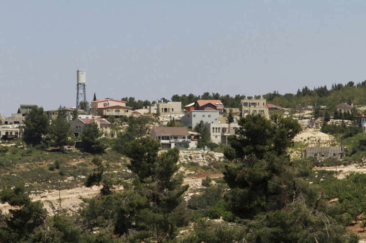 ADVANCE FOR USE MONDAY, APRIL 21, 2014 AND THEREAFTER - This Friday, April 18, 2014 photo shows the Jewish settlement of Bat Ayin, north of the West Bank city of Hebron. The settlement is known for its hardline population. While Israeli settlers in the West Bank fall mostly under civilian rule, Palestinians are subject to Israeli military law. Israeli and Palestinian youths face inequities at every stage in the path of justice, from arrests to convictions and sentencing, according to police statistics obtained by The Associated Press through multiple requests under Israel's freedom of information law. (AP Photo/Nasser Shiyoukhi)