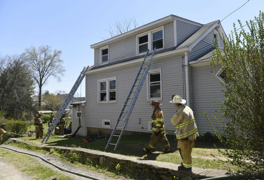 Stamford firefighters respond to a house fire at 118 Webb Ave. in Stamford, Conn. Sunday, April 24, 2016.