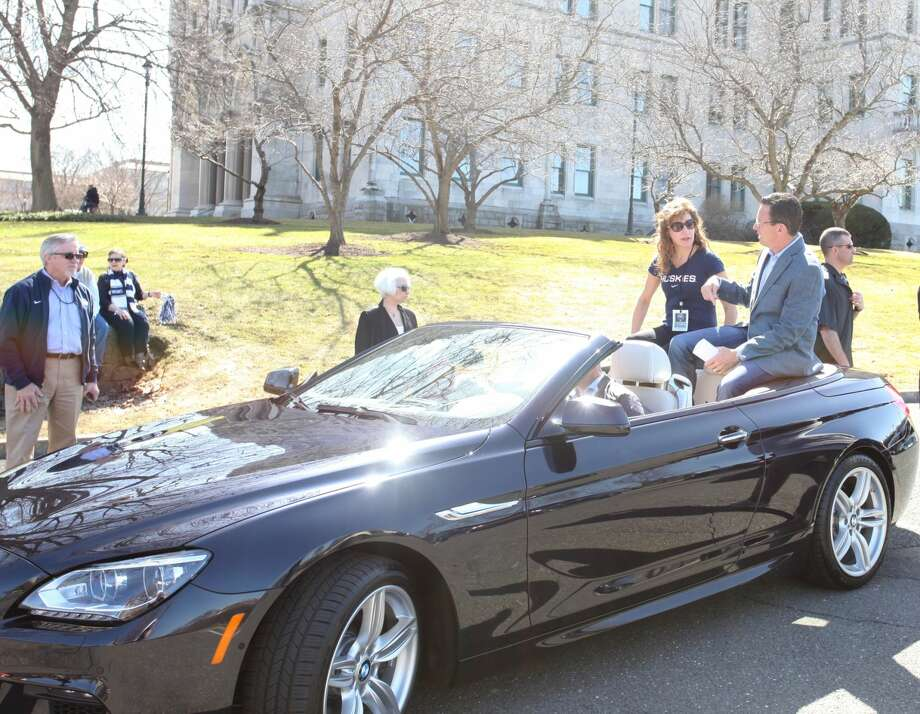 UConn Parade Goers Catch Husky Fever in a Beemer!