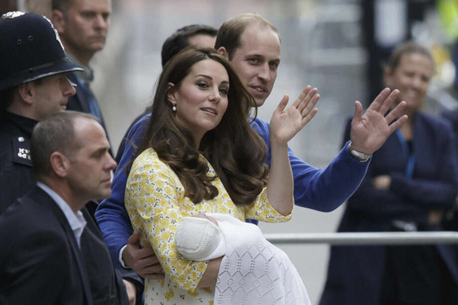 Britain's Prince William and Kate, Duchess of Cambridge and their newborn baby princess, wave to the public as they leave St. Mary's Hospital's exclusive Lindo Wing in London, Saturday, May 2, 2015. The Duchess gave birth to the Princess on Saturday morning. (AP Photo/Tim Ireland)