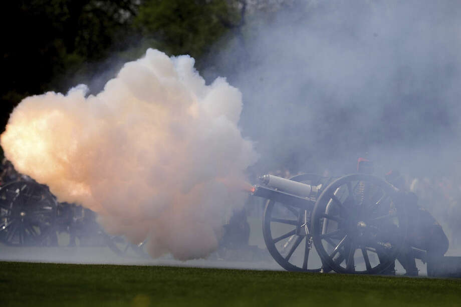 Soldiers of The King's Troop Royal Horse Artillery fire a 41 gun salute to mark the birth of the Duke and Duchess of Cambridge's second child, in Hyde Park, London, Monday, May 4, 2015. Gun salutes are traditionally fired for the birth of every British Prince or Princess. Britain's newborn princess has been named Charlotte Elizabeth Diana. The princess is the second child of Prince William and his wife Kate, the Duchess of Cambridge. The baby will be known as Her Royal Highness Princess Charlotte of Cambridge, royal officials said Monday. (AP Photo/Tim Ireland)