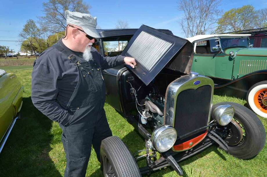 Skip Kern from Norwalk raises the hood for people on his 1931 Ford Model A Hi-Boy Hot Rod at the 42nd Annual Gateway Antique Auto Show at Taylor Farm on Sunday in Norwalk Conn. April 24 2016