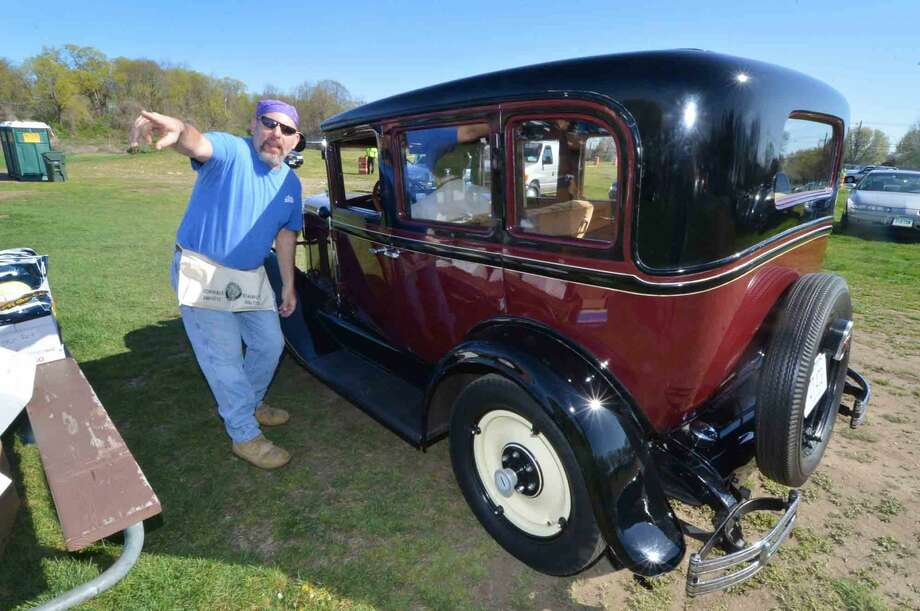 John Bragg directs cars where to park when they enter the gate at the 42nd Annual Gateway Antique Auto Show at Taylor Farm on Sunday in Norwalk Conn. April 24 2016