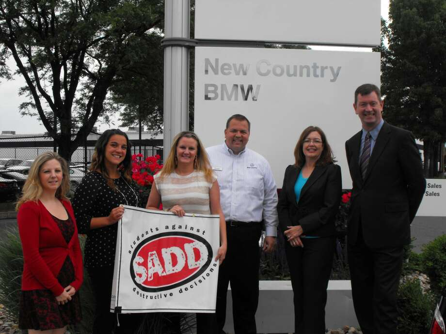 """PHOTO: New Country Motor Cars is kicking off its 2nd Annual""""Contract for Life"""" Campaign by donating $1 for each teen signature to not text and drive to the CT chapter of SADD.Last year the dealership presented a check to SADD for $500."""