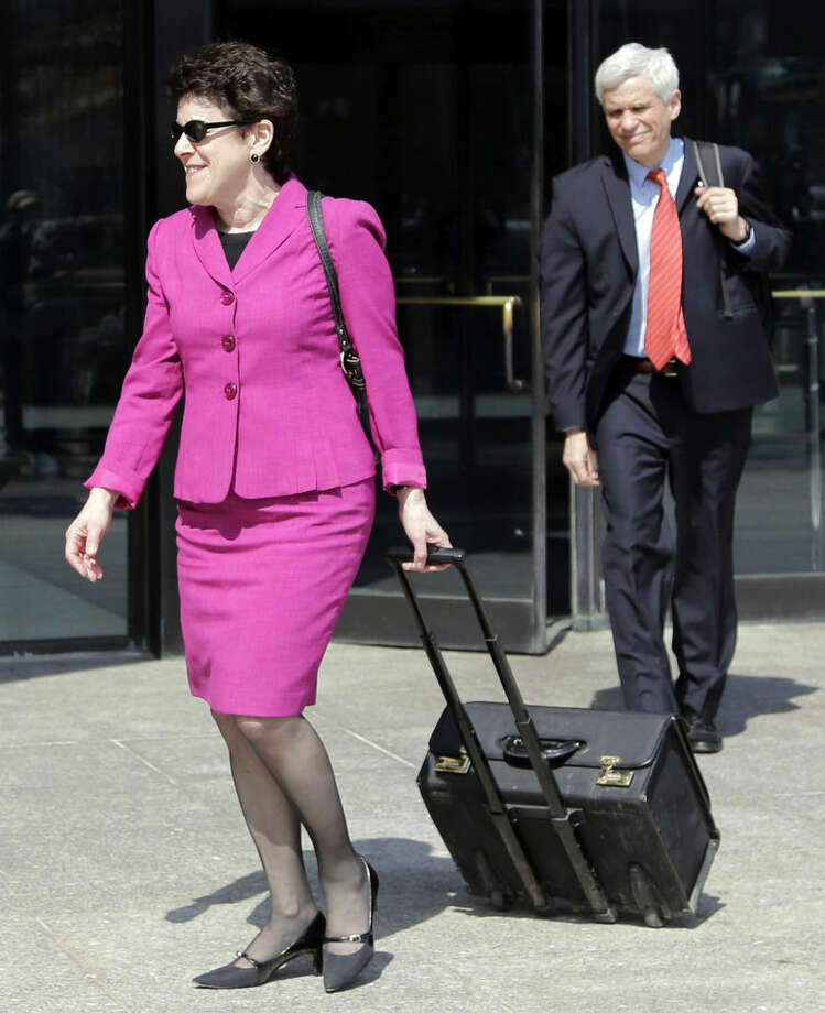 Defense attorneys Miriam Conrad, left, and David Bruck leave federal court in Boston, Monday, May 4, 2015, during the penalty phase in the trial of Dzhokhar Tsarnaev. Tsarnaev was convicted of the Boston Marathon bombings that killed three and injured more than 260 people in April 2013. (AP Photo/Elise Amendola)