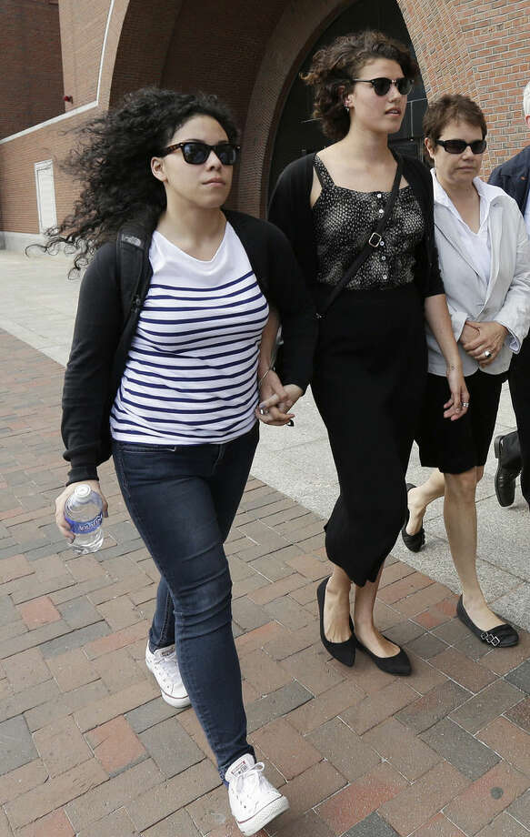 Former classmates of Dzhokhar Tsarnaev, Alexa Guevara, left, and Rosa Booth, center, depart federal court in Boston after testifying during the penalty phase in Tsarnaev's trial Monday, May 4, 2015. Tsarnaev was convicted of the Boston Marathon bombings that killed three and injured 260 people in April 2013. (AP Photo/Steven Senne)