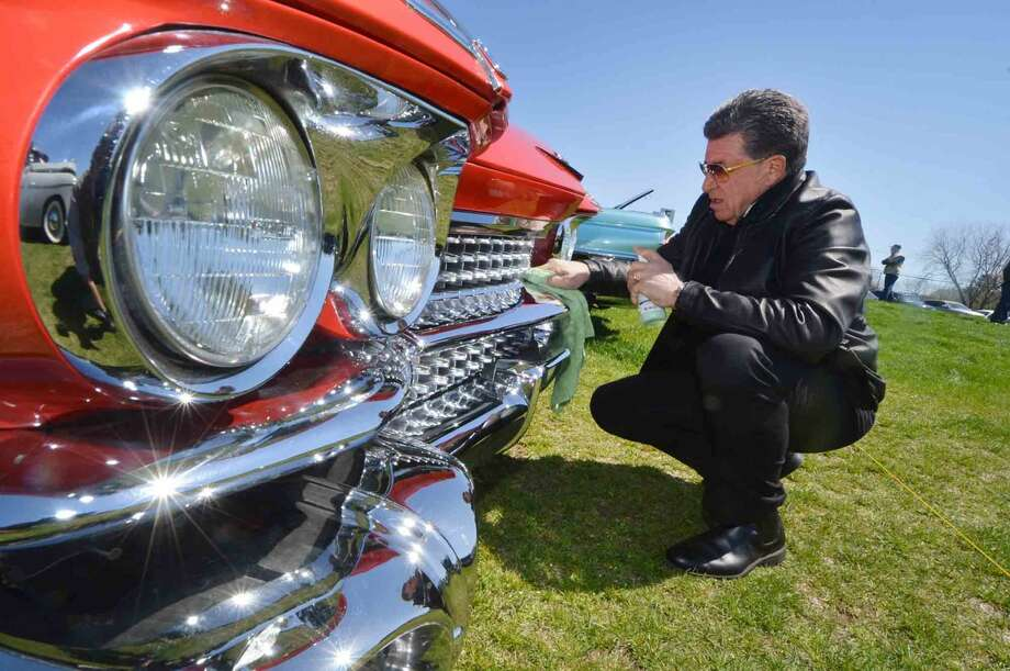 Stamfords Don Corbo helps his friend by polishing the front grille of his all original 1959 Series 62 Cadillac at the 42nd Annual Gateway Antique Auto Show at Taylor Farm on Sunday in Norwalk Conn. April 24 2016