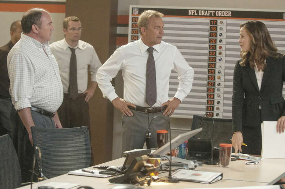 AP photoKevin Costner, center, and Jennifer Garner star in the movie Draft Day, which has seen its fair share of mixed reviews.