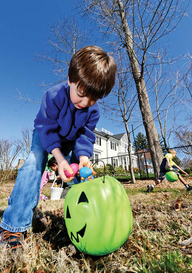 Hour photo / Erik Trautmann 5 year old Eric Behr searches for eggs at the Rowayton Civic Association annual Easter Egg Hunt at the Rowayton Community Center Saturday