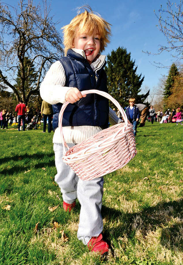 Hour photo / Erik Trautmann 3 year old Max Tangen searches for eggs at the Rowayton Civic Association annual Easter Egg Hunt at the Rowayton Community Center Saturday